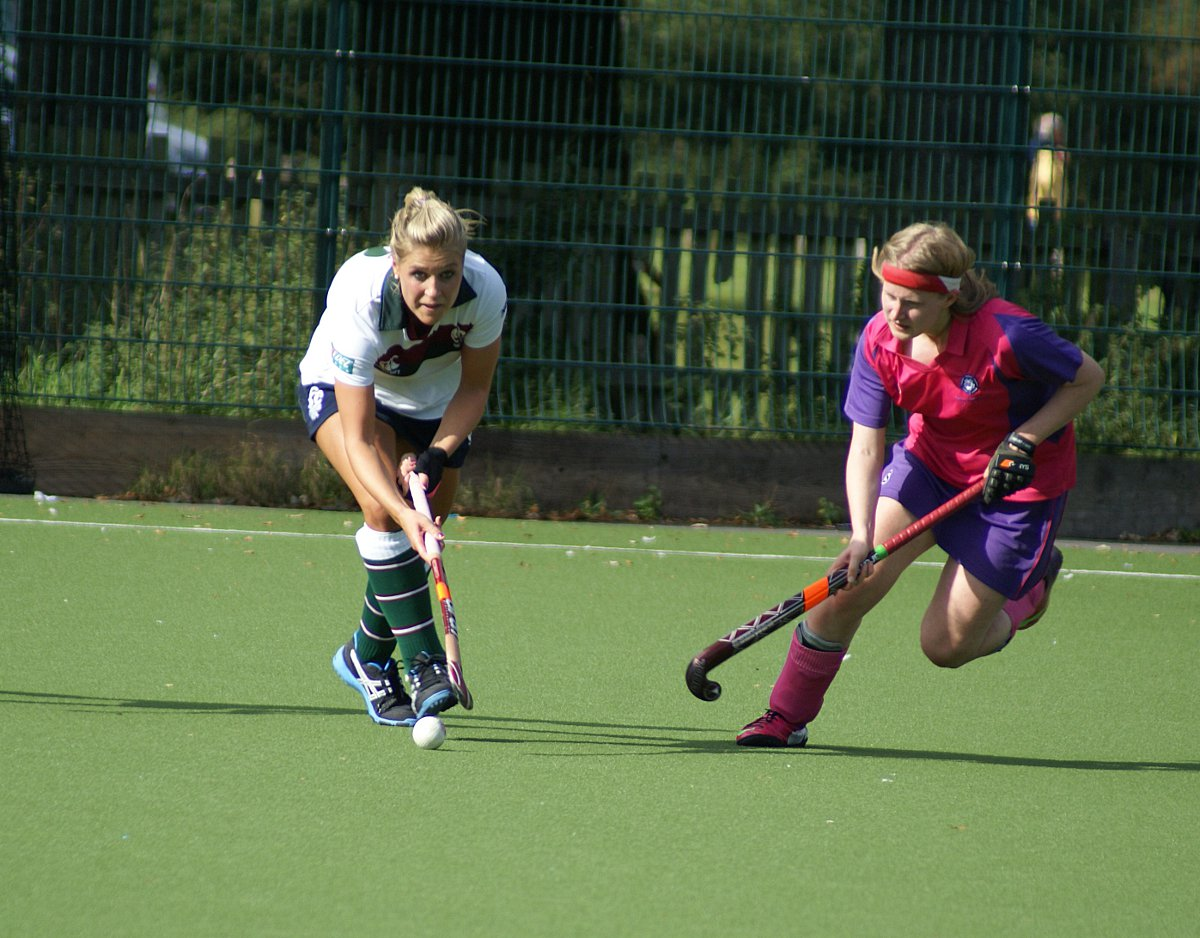 Big game player: Surbiton's Georgie Twigg, left,