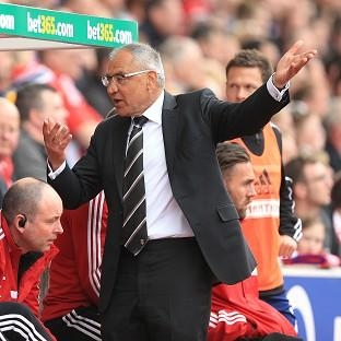 Felix Magath has vowed to remain as Fulham manager despite their relegation