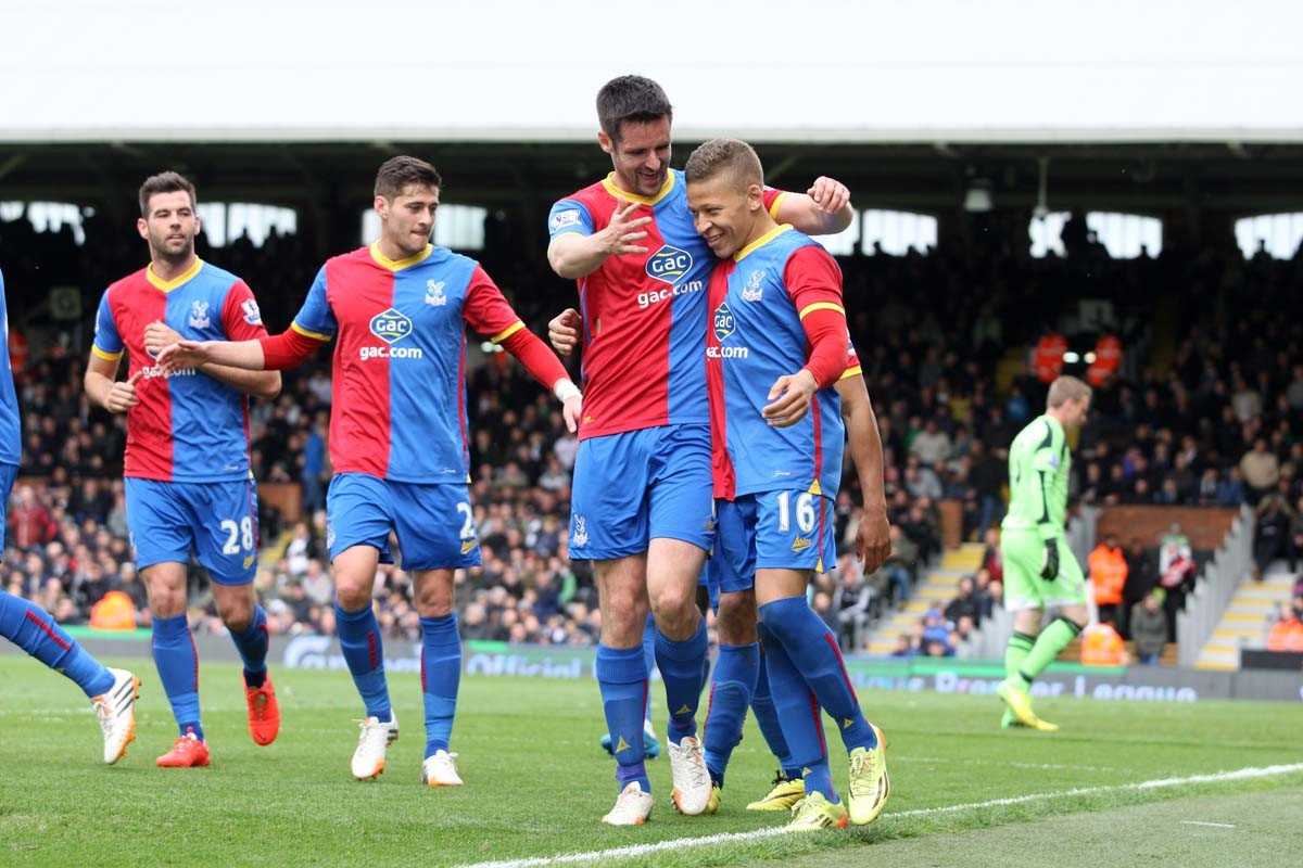 Happy times: Dwight Gayle gets the congratulations after his second goal against Fulham on Saturday