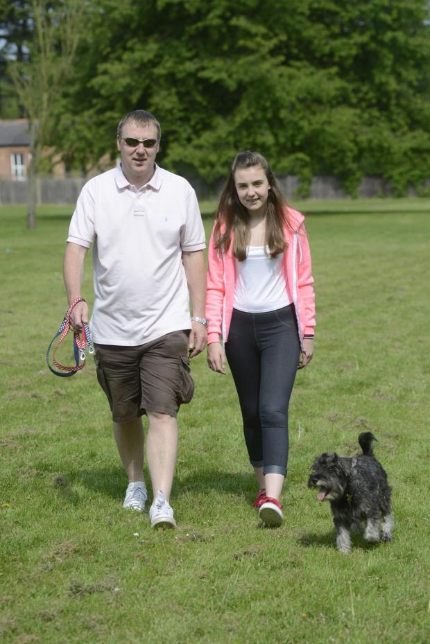 Richmond and Twickenham Times: Dog walkers Carl and Ellie Greenfield and dog Oscar enjoy the sunshine in Nonsuch Park, between Epsom and Sutton