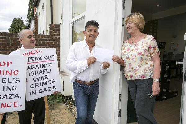 EastEnder: John Altman hands the petition in at Vince Cable's office