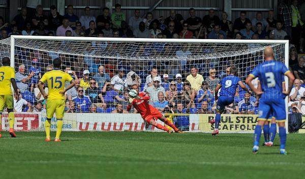 Hot-shot: Matt Tubbs buries a penalty past Mark Schwarzer in the pre-season defeat to Chelsea – it was his first goal in AFC Wimbledon colours, and he is  convinced there will be plenty more to come over the next few months						 Picture: David Purday