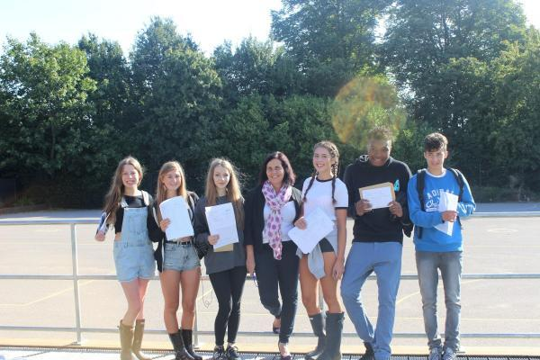 Delighted: Students at Grey Court School picked up their results this morning
