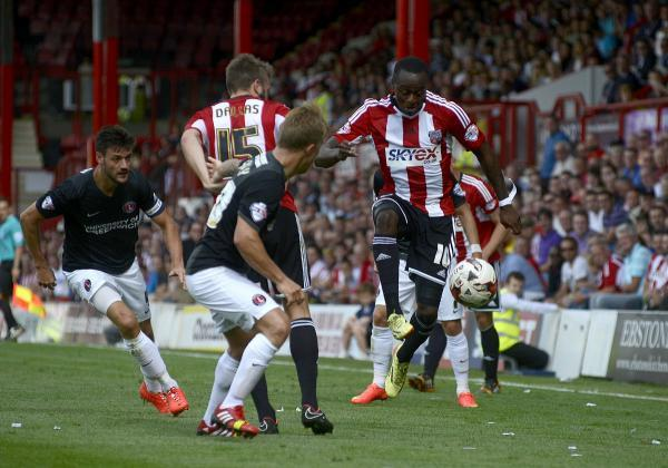 on target: Moses Odubajo, right, earned Brentford a point against Birmingham on Saturday