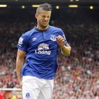 Richmond and Twickenham Times: Everton's Kevin Mirallas pulled up injured during the Merseyside derby