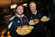 Aptly named: Former London Scottish prop Eric Fry, right, working at Nandos