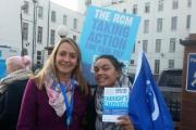'Taking Action For Fair Pay': Midwife Sam Peacock (left) on the picket line outside St Helier Hospital