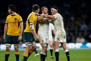 Spirit: England captain Chris Robshaw intervenes as Tom Wood clashes with Australia's Luke Jones      Picture: Getty Images