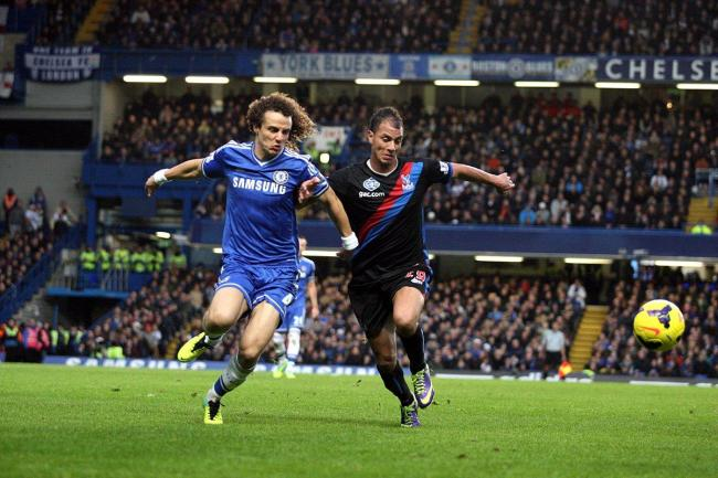 Hero or villain: David Luiz in his Chelsea days does battle with Crystal Palace striker Marouane Chamakh