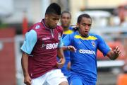 Long chase: Former AFC Wimbledon midfielder Brendan Kiernan, in action against West Ham United, has signed for Hampton & Richmond Borough