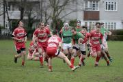 On the run: Ironsides' Liam Mills slices through the Longlevens defence