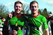 Champions: Skipper Colin O'Keeffe and Duncan Madden enjoy the liquid celebration