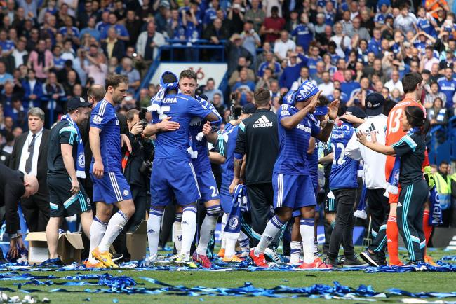 Happy days: Chelsea players celebrate victory over Crystal Palace, and the small matter of the Premier League title