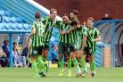Band of brothers: Andy Barcham celebrates his goal with a group of chums                         All pictures: David Hollins
