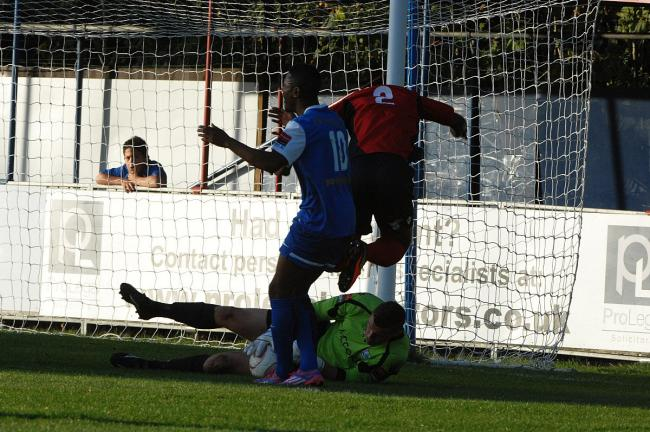 On the floor: Mark Smith makes a save against Grays Athletic at the Beveree last season