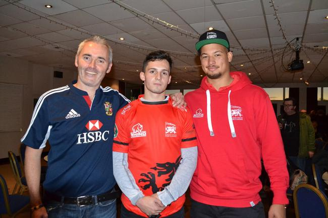 Flanked: London Wasps youngster Owain James, centre, with London Welsh minis chairman Gareth Vaughan Jones, left, and Welsh first team player Guy Armitage.