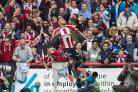 Back to what you know: Former Bees striker Andre Gray celebrates scoring against Wigan Athletic last season