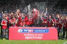 On the up: Brentford celebrate winning promotion from League One in 2014