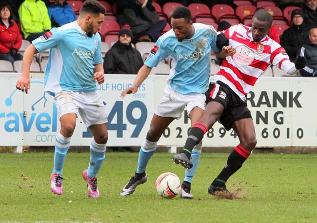 Goal man: Nicke Kabamba, centre, is among a host of Hampton stars thinking of the prospect of National League South football next term