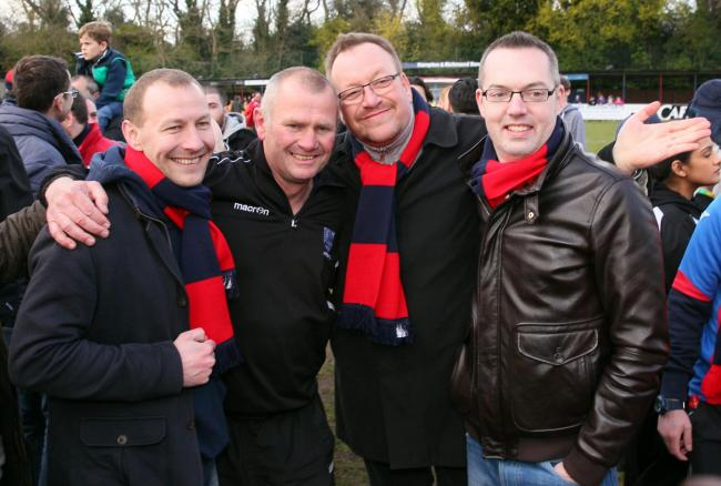 Cheers, lads: Hampton boss Alan Dowson, second from left, celebrates with fans on the Beveree pitch