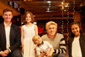 Niall Horan meets young cancer sufferers in bowling alley visit