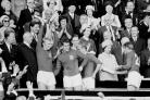 World champions: England captain Bobby Moore holds aloft the Jules Rimet trophy, followed by hat-trick hero Geoff Hurst, Bobby Charlton and Roger Hunt