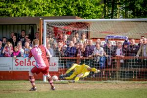 Dave Hodges, making his 300th appearance for Corinthian-Casuals, sees his decisive penalty saved by Slavomir Huk. Picture: Stuart Tree