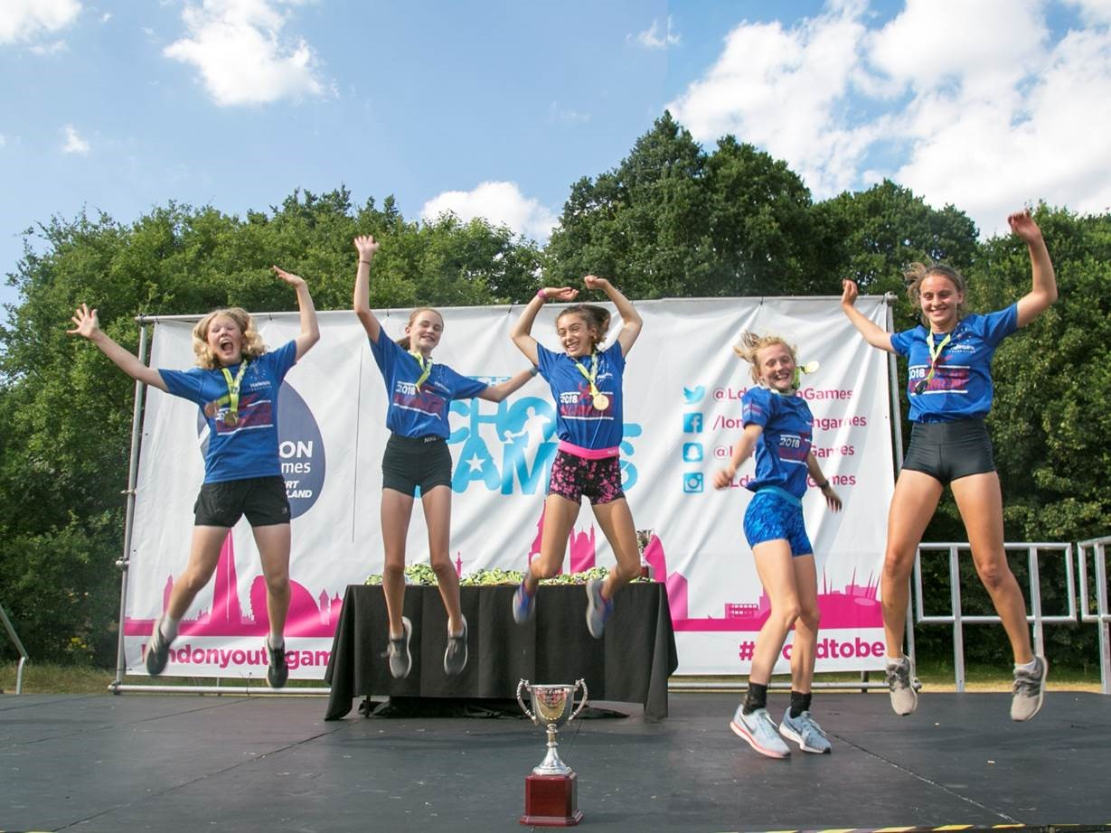 Team Richmond's girls athletics team jumping for joy at winning the overall team gold at the London Youth Games'