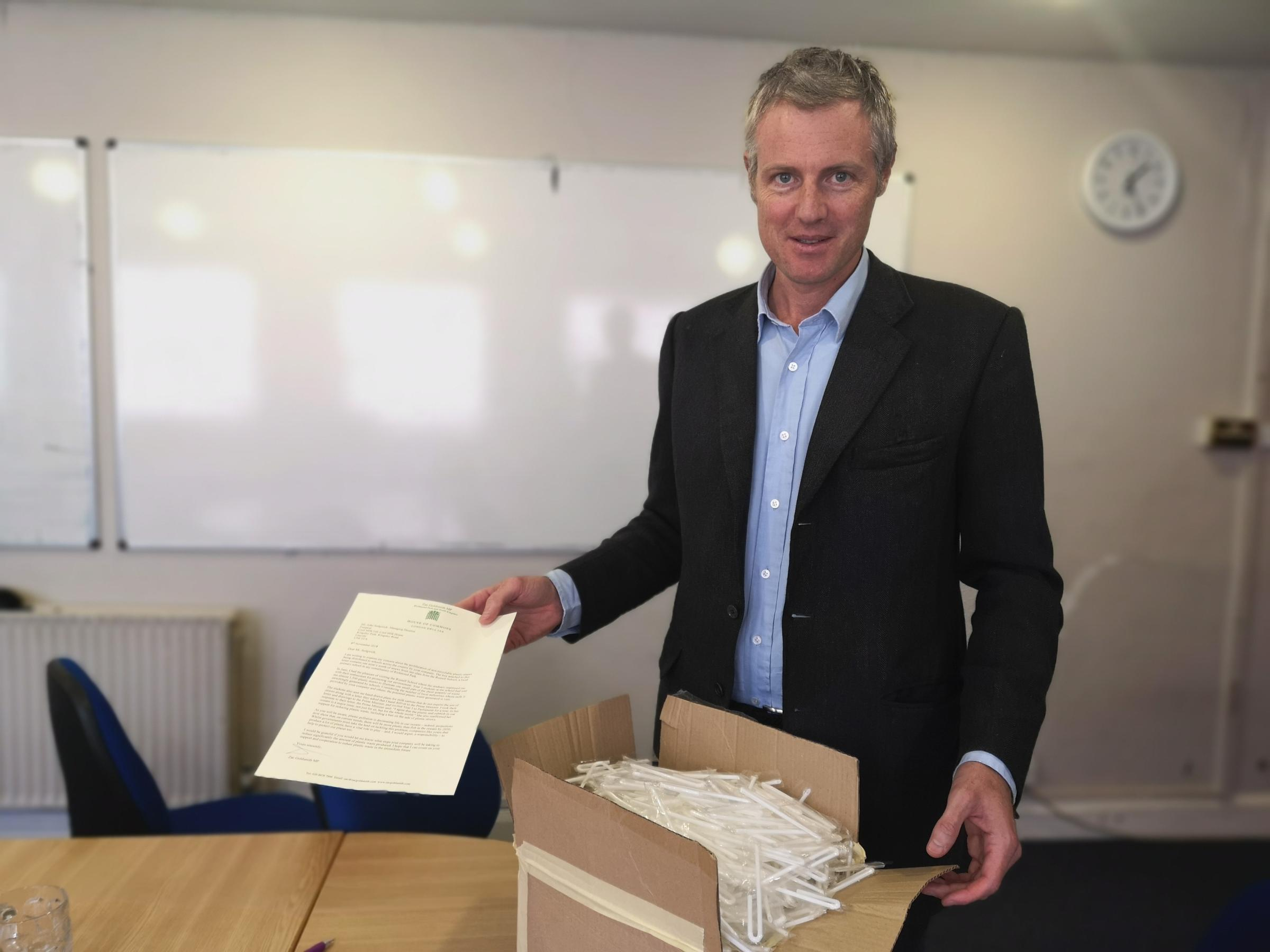 Zac Goldsmith MP with 1,500 straws sent into him by Russell School.