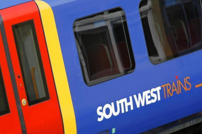 Person hit by train between Feltham and Wandsworth Town