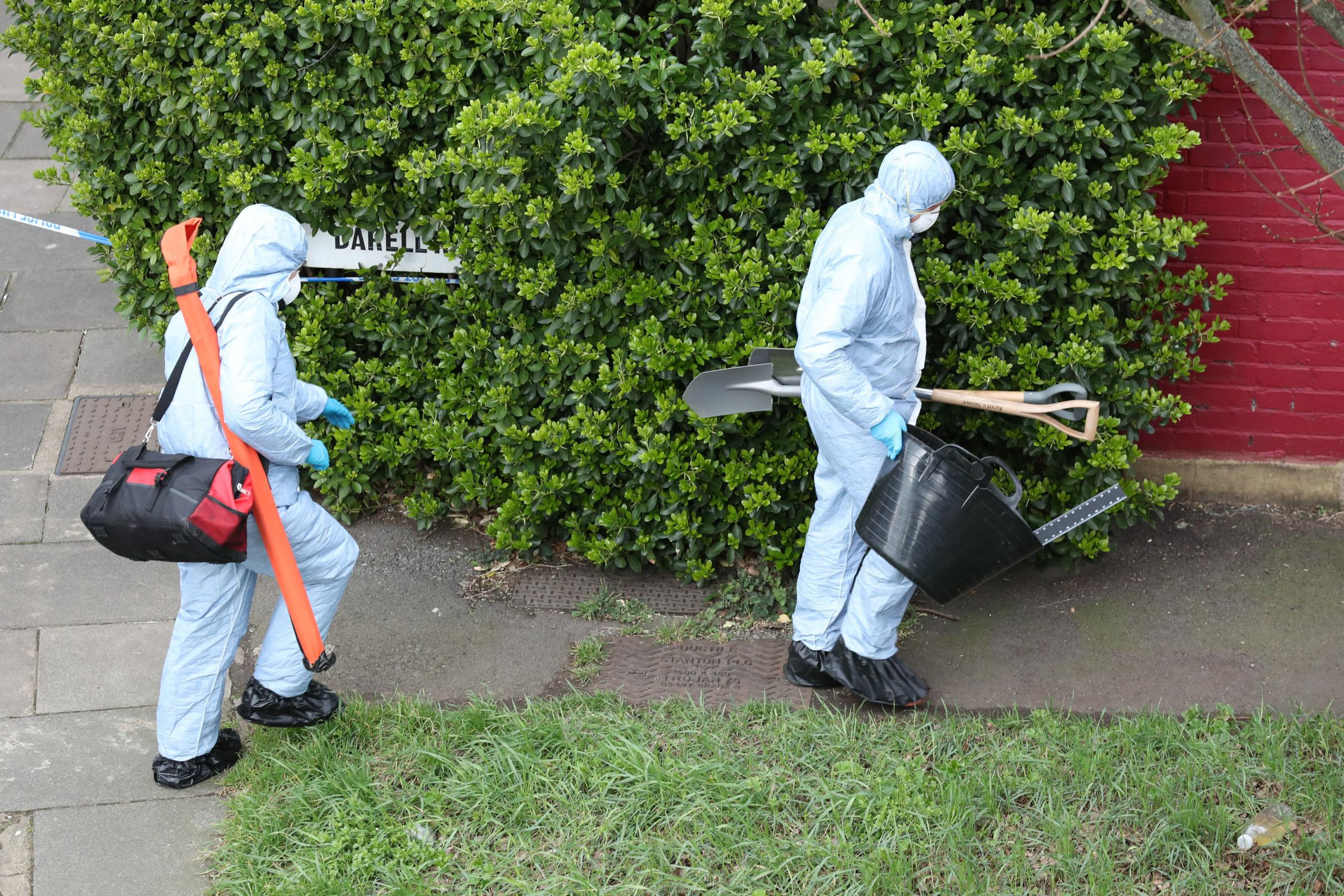Police forensics at a property on Darell Road in Kew. © PA