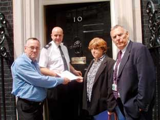 Philip and Marianne Lippiatt deliver the petition to 10 Downing Street with MP Alan Keen