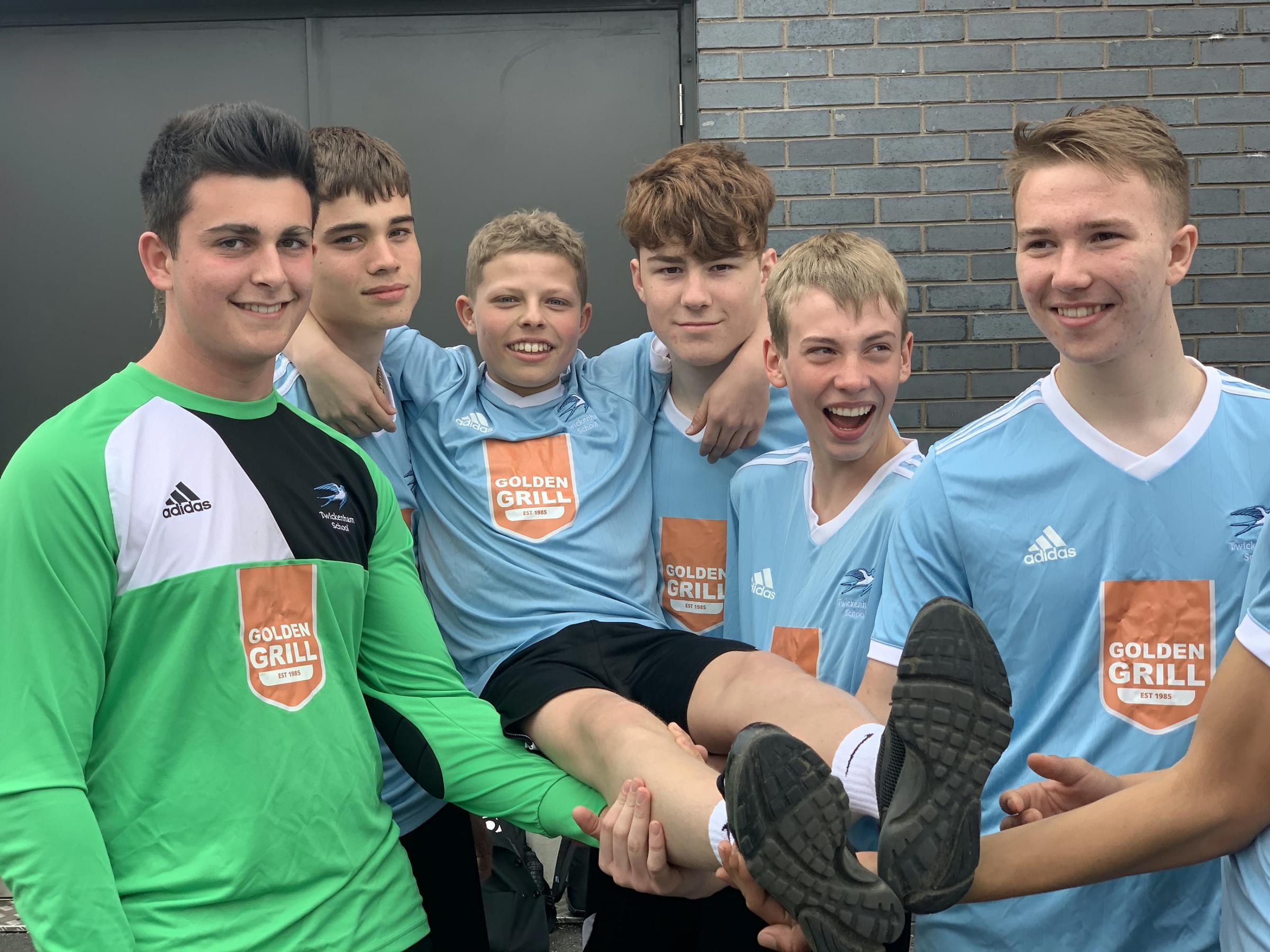 Aston Nunn being held up by his team mates in the Twickenham School Year 11 Boys Football team after they won the Richmond Schools cup 6-1.(l-r) Thomas Sant, Joe Hillier, Aston Nunn, Liam O�Callaghan, Lewis Phillips, Kiran Jones.See National News story NN