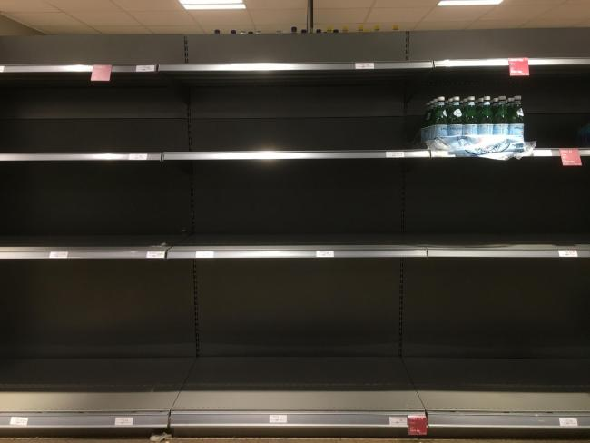 The water aisle in a Waitrose supermarket in Twickenham, as a burst pipe left large parts of London with little or no water (David Mirzoeff/PA)